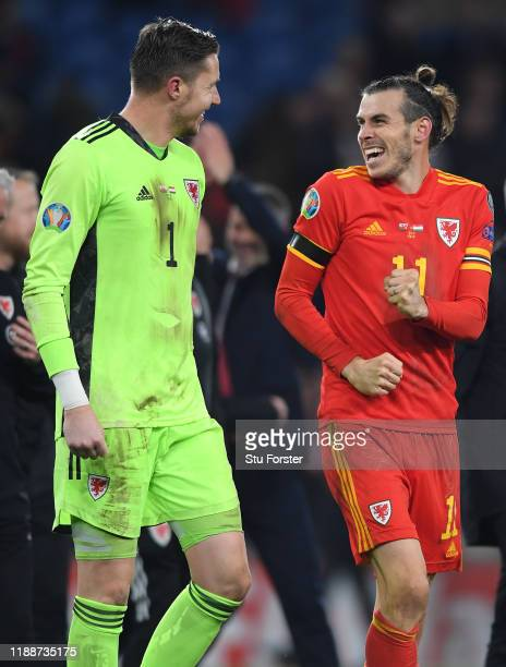 Wales player Gareth Bale celebrates with goalkeeper Wayne Hennessey after the UEFA Euro 2020 qualifier between Wales and Hungary at Cardiff City...
