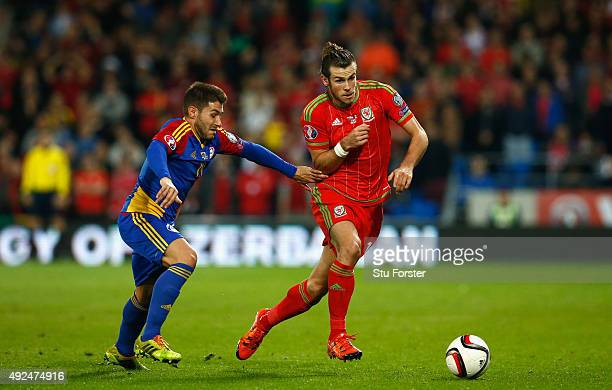 Wales player Gareth Bale goes past Ivan Lorenzo during the UEFA EURO 2016 Group B Qualifier between Wales and Andorra at Cardiff City stadium on...