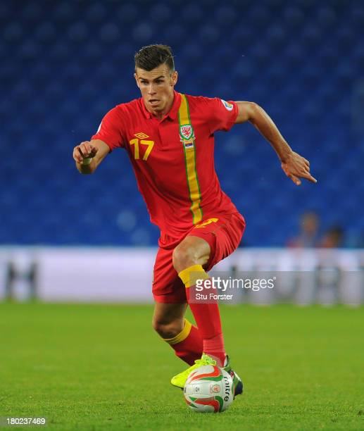 Wales player Gareth Bale in action during the FIFA 2014 World Cup Qualifier Group A match between Wales and Serbia at Cardiff City Stadium on...