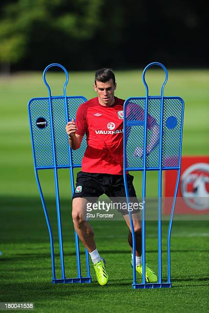 Wales player Gareth Bale in action during Wales training ahead of their World Cup qualifier against Serbia at the Vale resort on September 8 2013 in...