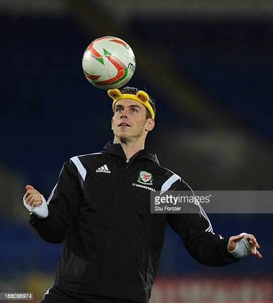 Wales player Gareth Bale in action wearing a set of Pudsey ears as part of the BBC Children In Need Charity campaign during the Wales press...