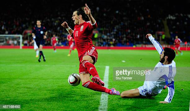 Wales player Gareth Bale is fouled by Charis Kyriakou of Cyprus during the EURO 2016 Qualifier match between Wales and Cyprus at Cardiff City Stadium...