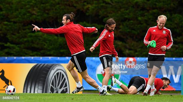 Wales player Gareth Bale laughs with Joe Allen Jonny Williams and Hal RobsonKanu during Wales training ahead of their UEFA Euro 2016 Semi final...