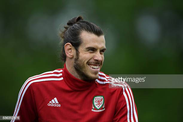 Wales player Gareth Bale shares a joke during Wales training at the Vale hotel complex on June 1 2016 in Cardiff Wales