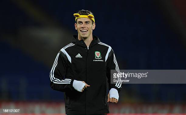 Wales player Gareth Bale shares a joke whilst wearing a set of Pudsey ears as part of the BBC Children In Need Charity campaign during Wales training...