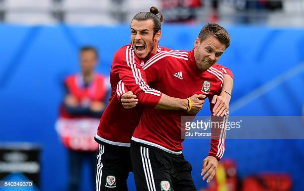 Wales player Gareth Bale shares a joke with Chris Gunter during Wales training ahead of their Euro 2016 match against England at Stade...