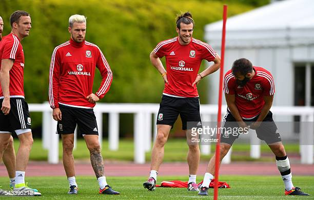 Wales player Gareth Bale shares a joke with Joe Ledley as Andy King and Aaron Ramsey look on during Wales training at their Euro 2016 base camp ahead...