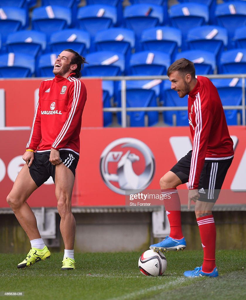 Wales player Gareth Bale shares a joke with team mate Aaron Ramsey during Wales training ahead of their UEFA European Championship qualiifying game against Israel on September 5, 2015 in Cardiff, United Kingdom.