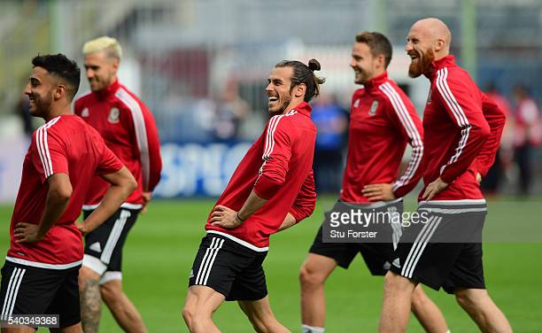 Wales player Gareth Bale shares a joke with team mates during Wales training ahead of their Euro 2016 match against England at Stade BollaertDelelis...