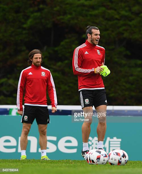 Wales player Gareth Bale shares a joke with team mates during Wales training session ahead of their Euro 2016 quarter final match against Belgium at...