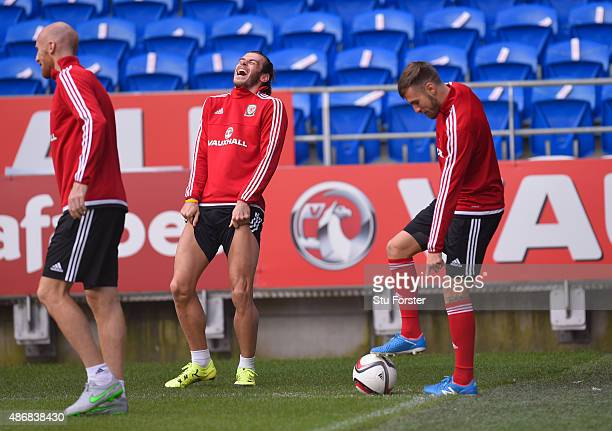 Wales player Gareth Bale shares a joke with team mates James Collins and Aaron Ramsey during Wales training ahead of their UEFA European Championship...