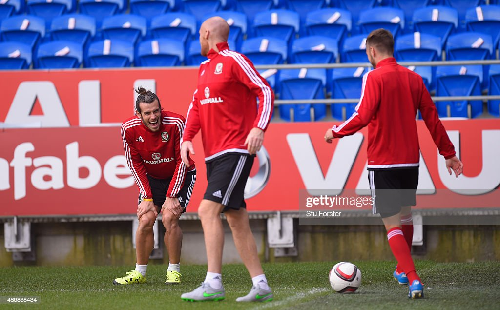 Wales player Gareth Bale shares a joke with team mates James Collins and Aaron Ramsey during Wales training ahead of their UEFA European Championship qualiifying game against Israel on September 5, 2015 in Cardiff, United Kingdom.