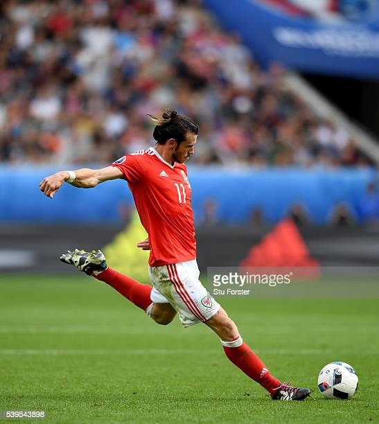 Wales player Gareth Bale takes a direct free kick during the UEFA EURO 2016 Group B match between Wales and Slovakia at Stade Matmut Atlantique on...