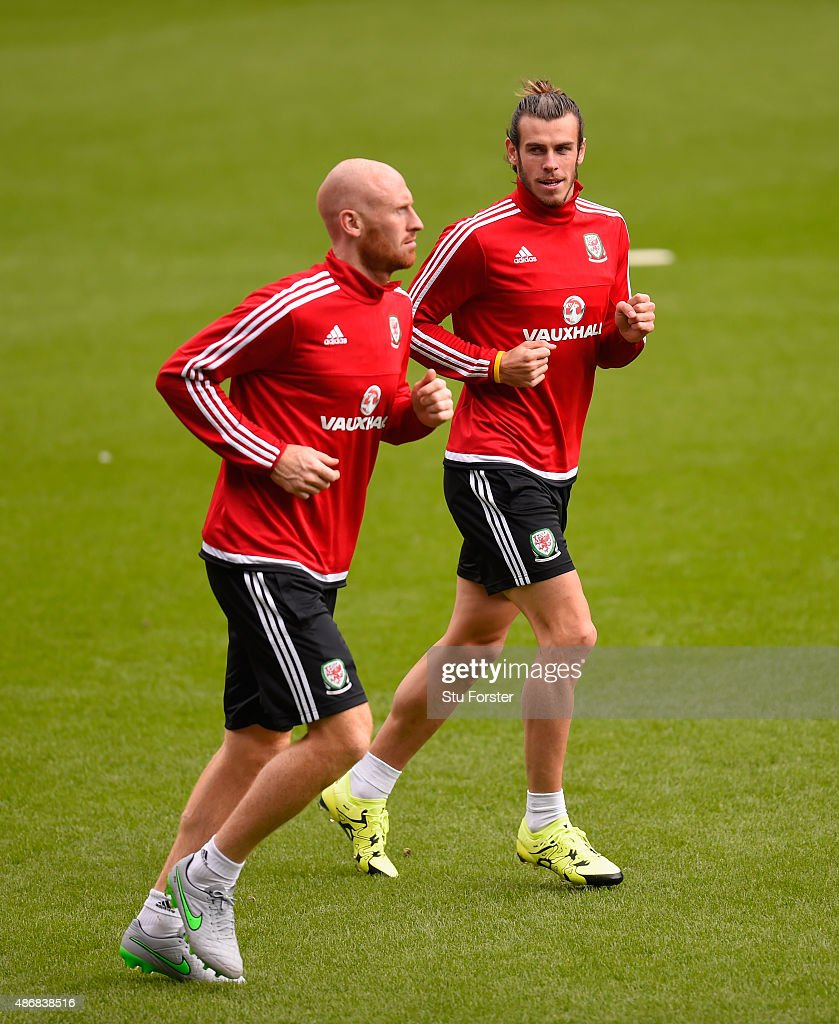 Wales player Gareth Bale (r) warms up with team mate James Collins during Wales training ahead of their UEFA European Championship qualiifying game against Israel on September 5, 2015 in Cardiff, United Kingdom.