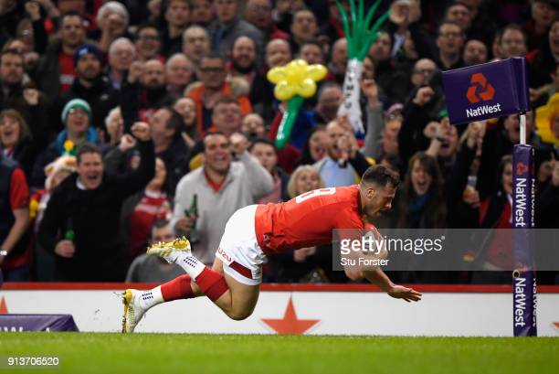 Wales player Gareth Davies dives over to score the first try of the game during the NatWest 6 Nations game between Wales and Scotland at Principality...