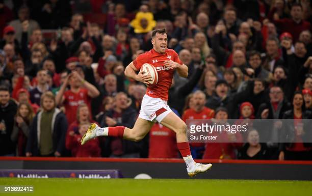 Wales player Gareth Davies races away to score the first try of the game during the NatWest 6 Nations game between Wales and Scotland at Principality...