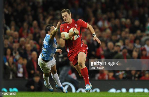 Wales player George North bursts past Horacio Agulla to score the second Wales try during the International Match between Wales and Argentina at the...