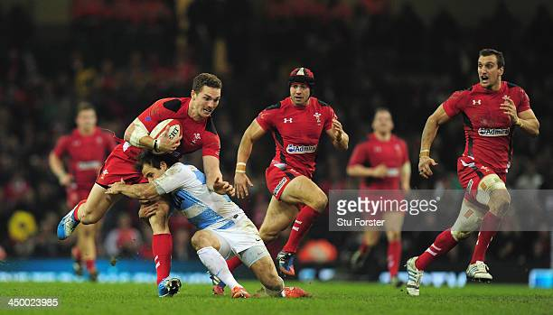 Wales player George North rides the tackle of Lucas Gonzalez of Argentina during the International Match between Wales and Argentina at the...