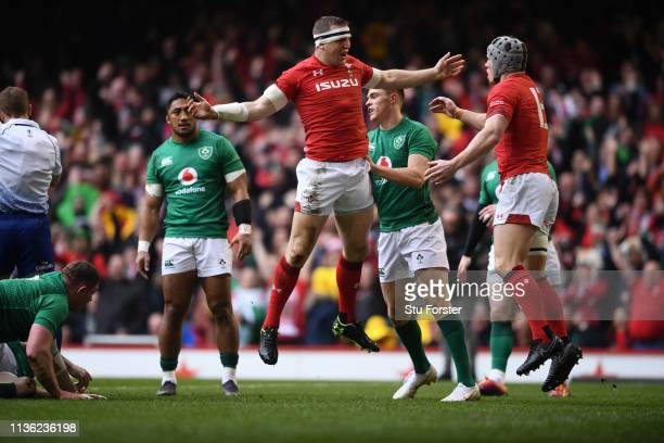 Wales player Hadleigh Parkes celebrates his try with Jonathan Davies during the Guinness Six Nations match between Wales and Ireland at Principality...