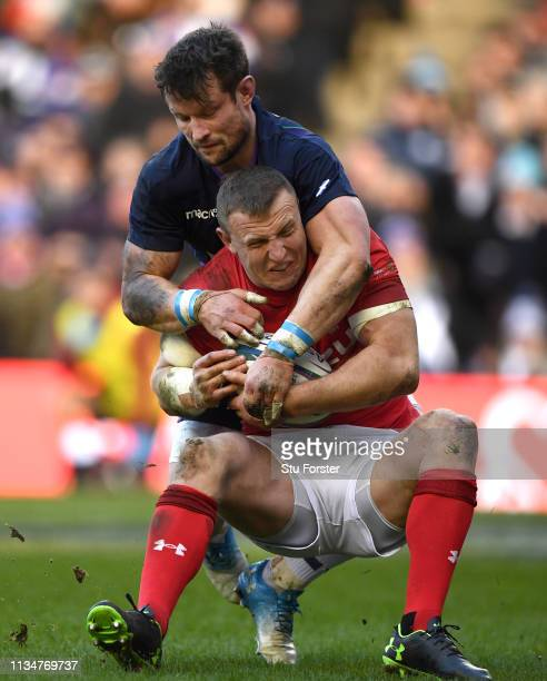 Wales player Hadleigh Parkes is tackled by Peter Horne during the Guinness Six Nations match between Scotland and Wales at Murrayfield on March 09...