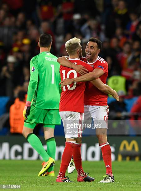 Wales player Hal RobsonKanu celebrates with Aaron Ramsey on the final whistle after the UEFA Euro 2016 Quarter Final match between Wales and Belguim...