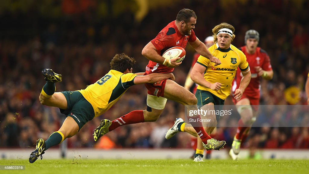 Wales player Jamie Roberts is tackled by Wallabies player Nick Phipps during the Autumn international match between Wales and Australia at Millennium Stadium on November 8, 2014 in Cardiff, Wales.