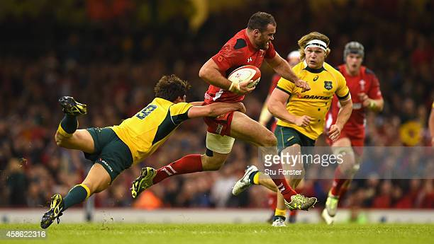 Wales player Jamie Roberts is tackled by Wallabies player Nick Phipps during the Autumn international match between Wales and Australia at Millennium...