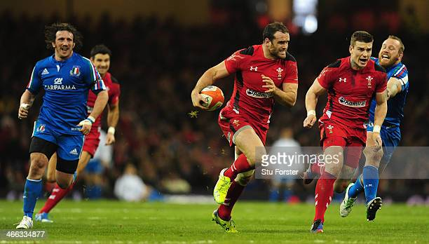 Wales player Jamie Roberts makes a break before setting up Scott Williams for the second Wales try during the RBS Six Nations match between Wales and...