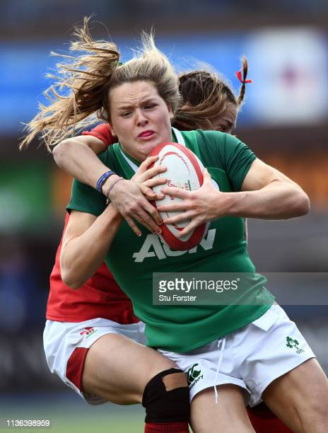 Wales player Jasmine Joyce tackles Ireland wing Beibhinn Parsons during the Wales Women v Ireland Women match in the Women's Six Nations at Cardiff...
