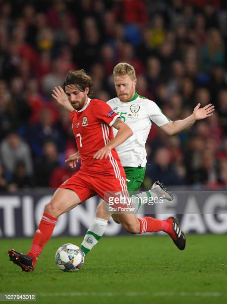 Wales player Joe Allen holds off the challenge of Daryl Horgan of Ireland during the UEFA Nations League B group four match between Wales and...