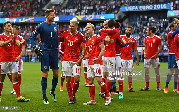 Wales player Jonathan Williams and team mates celebrate after the Round of 16 UEFA Euro 2016 match between Wales and Northern Ireland at Parc des...