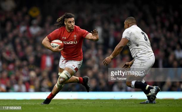 Wales player Josh Navidi runs at Kyle Sinckler during the Guinness Six Nations match between Wales and England at Principality Stadium on February 23...