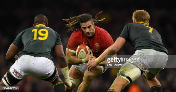 Wales player Josh Navidi runs at the Springboks defence during the International between Wales and South Africa at at Principality Stadium on...