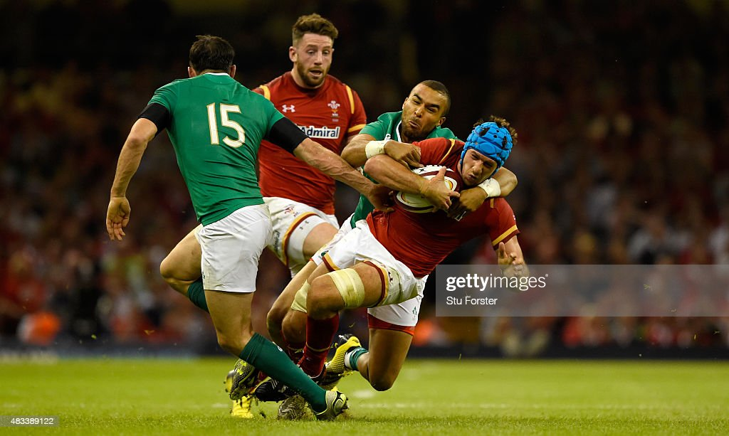 Wales player Justin Tipuric is tackled by Ireland player Simon Zebo during the Rugby World Cup warm up match between Wales and Ireland at Millennium Stadium on August 8, 2015 in Cardiff, Wales.