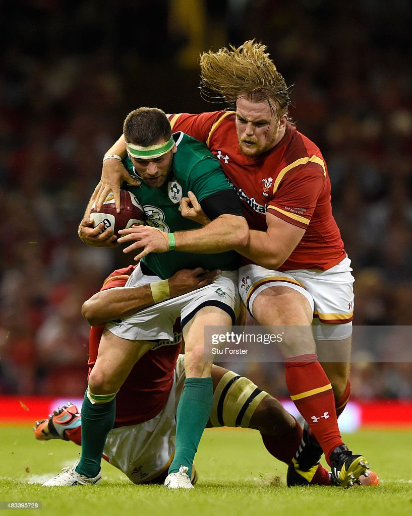 Wales player Kristian Dacey (r) tackles Ireland player Fergus McFadden during the Rugby World Cup warm up match between Wales and Ireland at Millennium Stadium on August 8, 2015 in Cardiff, Wales.