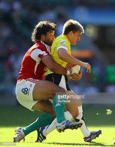 Wales player Lee Rees breaks is tackled by Gancalo Foro of Portugal during the Pool B game between Kenya and Wales during day one of the IRB London...