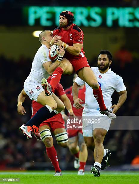 Wales player Leigh Halfpenny and Mike Brown of England compete for a high ball during the RBS Six Nations match between Wales and England at...