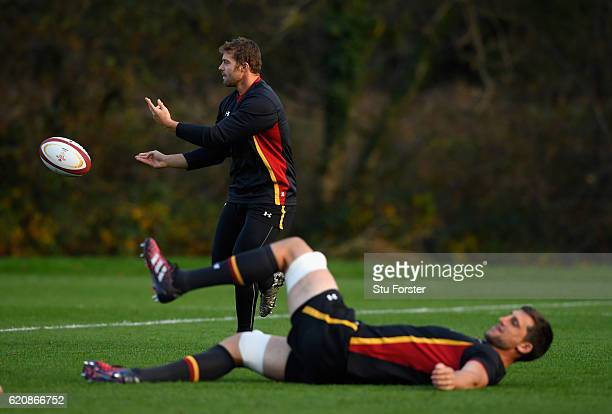 Wales player Leigh Halfpenny in action as Luke Charteris warms up during Wales training in the lead up to the game against Australia at the Vale...