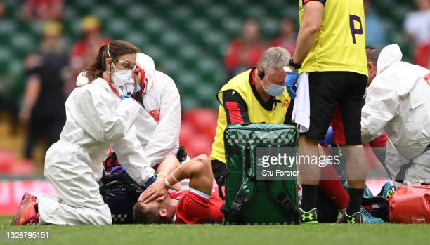 Wales player Leigh Halfpenny receives medical attention before being stretchered off with an injury during the International Match between Wales and...