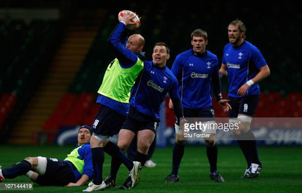 Wales player Martyn Williams in action as captain Matthew Rees looks on during Wales training at Millennium Stadium on November 25 2010 in Cardiff...