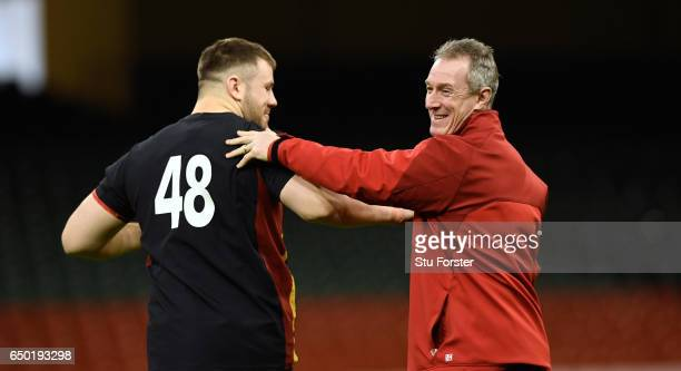 Wales player Rob Evans shares a joke with head coach Robert Howley during Wales captain's run ahead of their RBS Six Nations match against Ireland at...