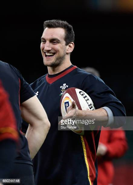 Wales player Sam Warburton enjoys a joke with a team mate during Wales captain's run ahead of their RBS Six Nations match against Ireland at...