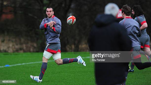 Wales player Sam Warburton in action under the watchfull eye of coach Warren Gatland during Wales training ahead of their RBS Six Nations match...