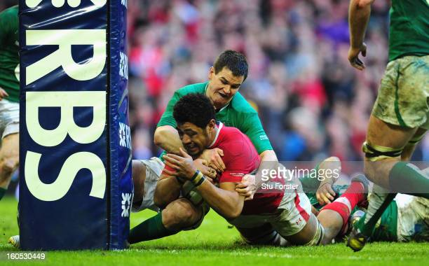 Wales player Toby Faletau is stopped by Jonny Sexton just short of the try line during the RBS Six Nations game between Wales and Ireland at the...