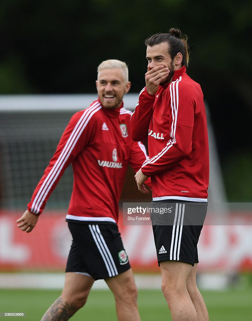 Wales players Aaron Ramsey (blonde hair) and Gareth Bale share a joke during Wales training at the Vale hotel complex on June 1, 2016 in Cardiff, Wales.