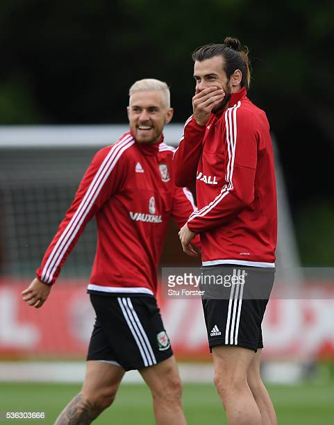 Wales players Aaron Ramsey and Gareth Bale share a joke during Wales training at the Vale hotel complex on June 1 2016 in Cardiff Wales