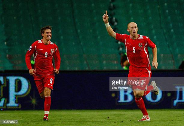 Wales players Aaron Ramsey and goalscorer James Collins celebrate after the first Wales goal during the FIFA 2010 World Cup Qualifier between Wales...
