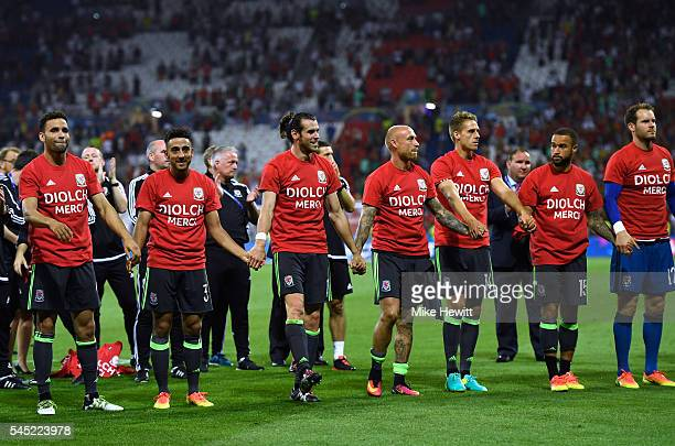 Wales players and staffs applaud supporters after the UEFA EURO 2016 semi final match between Portugal and Wales at Stade des Lumieres on July 6 2016...