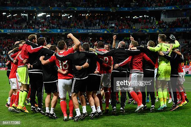 Wales players and staffs celebrate their team's 31 win after the UEFA EURO 2016 quarter final match between Wales and Belgium at Stade PierreMauroy...