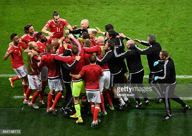 Wales players and staffs celebrate their team's second goal by Hal RobsonKanu during the UEFA EURO 2016 quarter final match between Wales and Belgium...